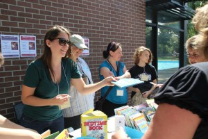 Volunteers hand out free books
